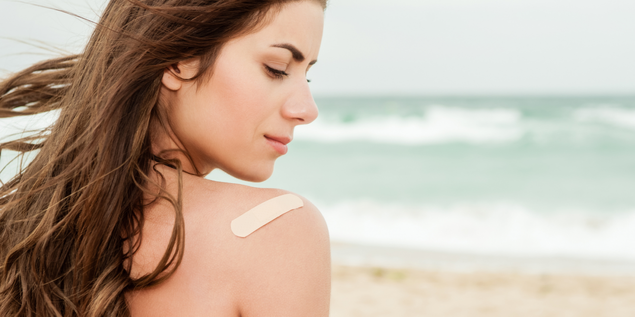 woman with bandaid on beach