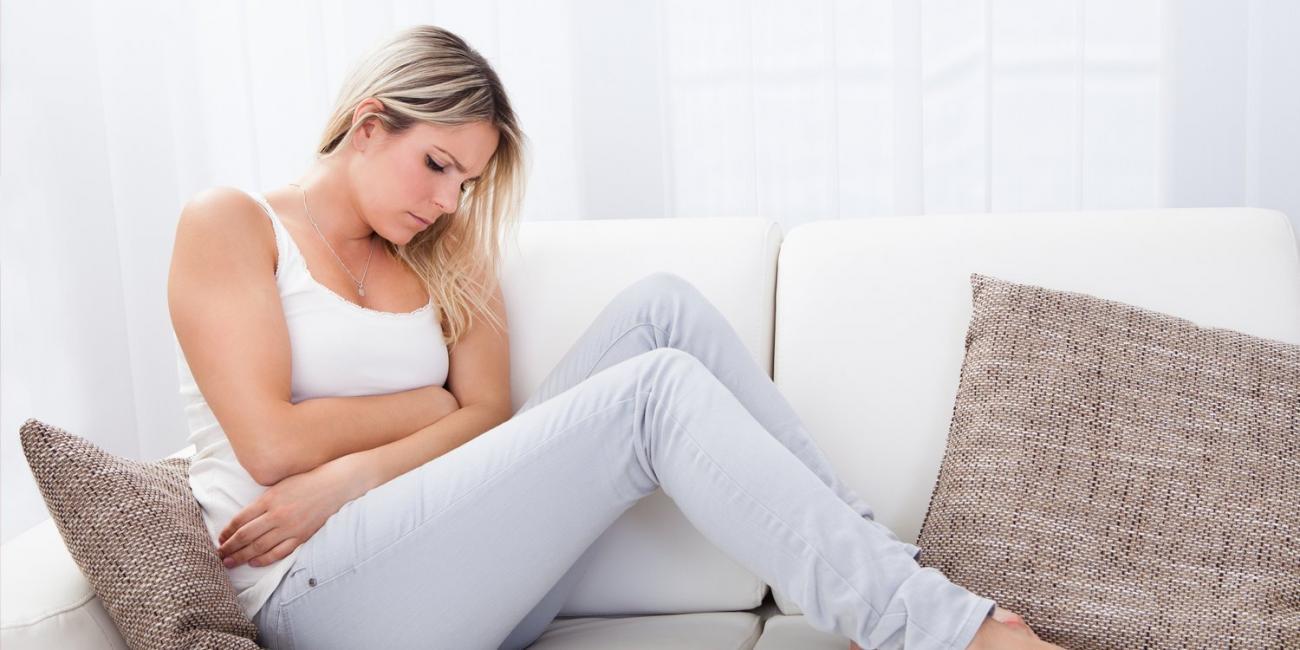 woman in pain from heartburn